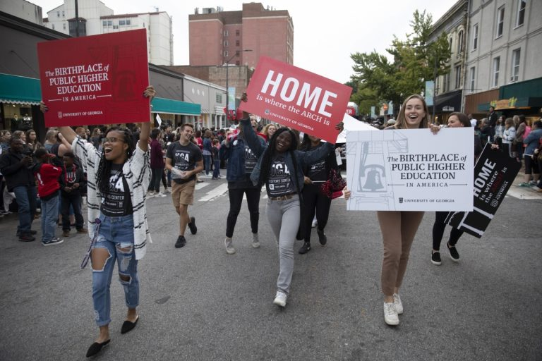 Students marching in the Homecoming parade