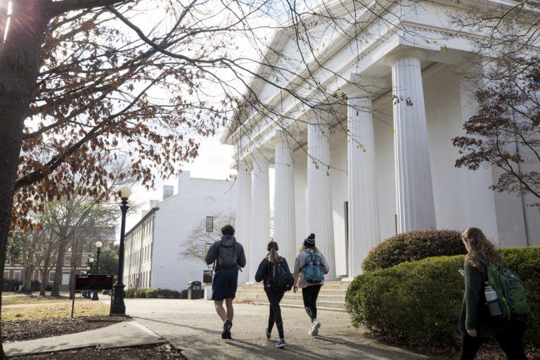 Students walking past chapel