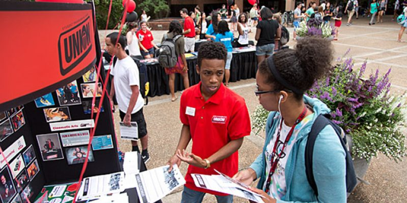 Students talking at the student involvement fair